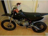 Stomp 160cc pitbike with big wheel conversion