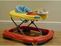 Baby walker with removable toy