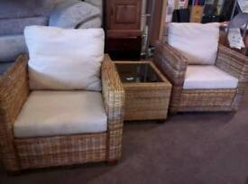 Wicker chairs and coffee table