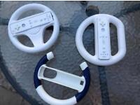 3 x Nintendo wii steering wheels with 2 controllers