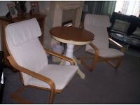 2 cream poang chairs and solid wood pedestal table