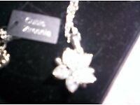 NEW FLOWER PENDANT, FILLED WITH 10 CARAT WEIGHT OF ZIRCON,, WITH EXTENDER CHAIN