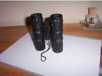 Two pair of BARSKA lucid view Binoculars one pair in a carrying case