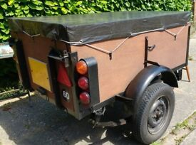 Trailer with cover, ladder support, spare wheel, electrics, tools, suspension, marine ply