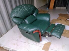 Reclining green leather armchair
