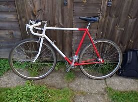 Vintage Red and White Raleigh road bike