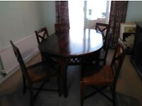 Dark wood dinning room table with matching sidboard