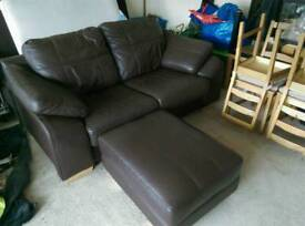 Brown leather 2 seated sofa and footstool