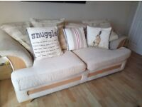 Two large cream DFS sofas and a footstool (from non-smoking home)