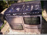 NEW WORLD DUAL FUEL RANGE COOKER. 110 CM. STAINLESS STEEL.