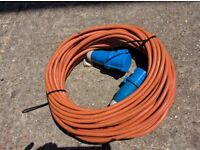 Orange electric mains cable, very long