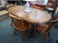 pine dining tablewith four chairs