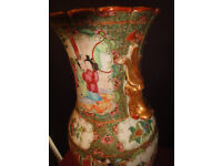 A Cantonese 19th Century vase decorated with flowers and foliage, approx 36cm tall