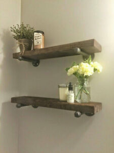 Rustic wood shelf with industrial pipe mount