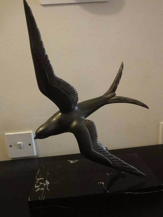 Art Deco bronze metal figure of a Swift in Flight standing on a marble base 1920s 38cm high
