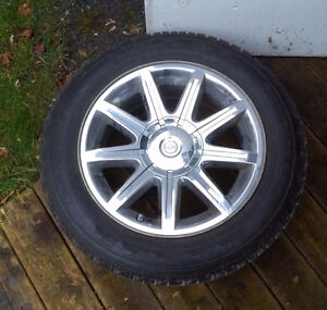Pair of mint Firestone Winterforce tires on Chysler 300 rims