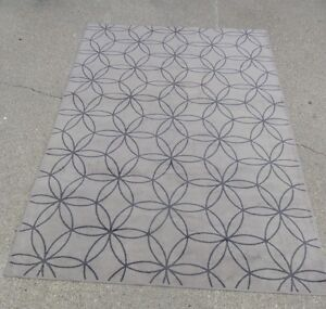 4 Assorted Area Rugs (some are brand new)