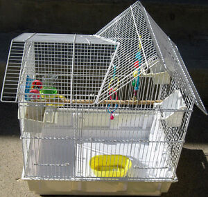 bird cage with many accessories