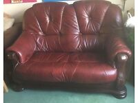 Real leather and wood two seater sofa