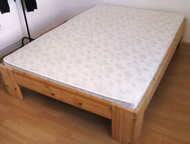 Double bed with full wooden slatted frame and medium firm mattress
