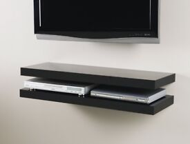 3 x Black wooden floating shelves.