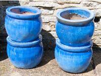 4 ceramic plant pots.