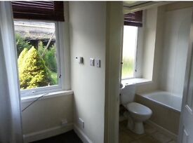 Two bedroom (one en-suite) ground floor flat for rent. £450 per calendar month. Shared garden.