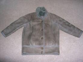 Ladies grey blouson style sheepskin coat. Very good condition. Size 12.