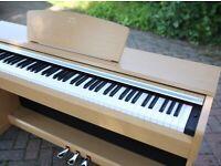 Yamaha Arius YDP-141 piano, stool and music books