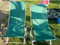 Two high quality metal framed deck chairs
