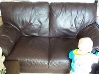 Free... Brown two seater sofa good condition..