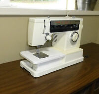 Singer sewing machine and cabinet reduced