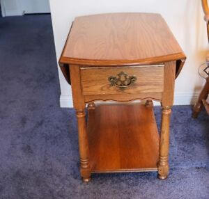 Solid Oak end table with drop-down sides and handy drawer