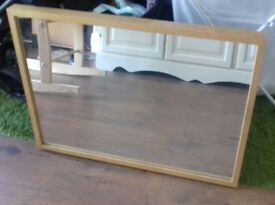 Light wood framed mirror