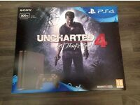 PS4 Slim 500GB boxed with games - excellent condition