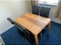 Beech wood dining room table and 4 leather chairs £125