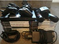 (sold pending collection) Black PS2 slim with 14 games + extras