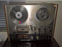 Akai 4000DB reel to reel and 45 tape reels