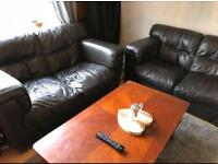 Pair of brown two seater leather sofas