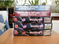 THREE WASGIJ AND TWO WORLD'S MOST DIFFICULT JIGSAW PUZZLES ALL COMPLETE
