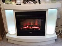 Statement piece electric fire with surround