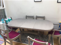 Beautiful shabby chic dining table 6ft w 6 chairs. Extendable. 8 can seat