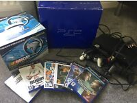 Playstation 2 bundle with controllers, games and Nascar racing wheel