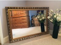 Ornate gold frame mirror with bevel edge glass