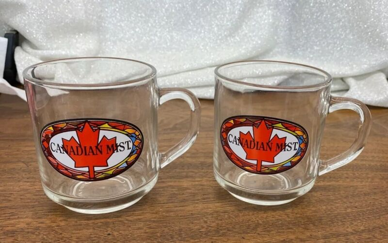 """2 """"Canadian Mist"""" Clear Advertising Mugs with Handles"""