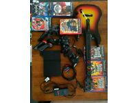 Sony PS2 slim with games and controllers