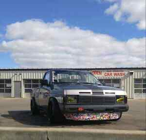 Dirst Nasty Lows Nissan D21 Mini Truck, Stretched Tires and All!