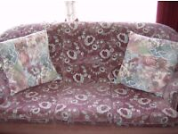 Rose coloured. Pattered velour suite