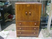 nice solid cupboard with 3 draws good condition