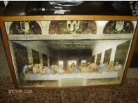 large frame with last supper poster.